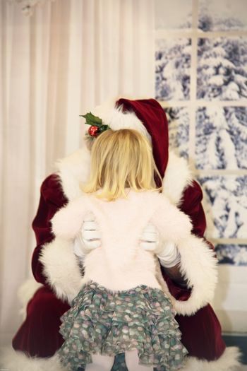 Is it really you Santa? One Person Rear View Women Real People Hair Winter Christmas Lifestyles Indoors  Hairstyle Childhood Celebration Focus On Foreground Adult Leisure Activity Cold Temperature Blond Hair Warm Clothing Clothing