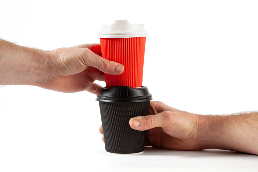 Male hands holding stacked plastic coffee cups on white background with copy space Coffee Time Copy Space Red Black Body Part Close-up Coffee Break Coffee Cups Coffee Cups In A Row Container Copy Space Cut Out Disposable Cups Drink Finger Food And Drink Hand Holding Human Body Part Human Hand Human Limb Indoors  Male Hand Men Occupation People Placing Plastic Recyclable Items Red Studio Shot Taking  Template White Background White Color