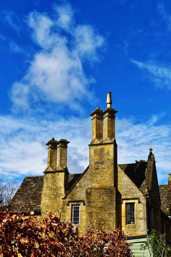 Cotswold house Photowalktheworld Cotswolds Countryside Nikonphotographer Nikonphotography House Picturesque Village Blue Sky White Clouds Clock Clock Face Place Of Worship Clock Tower History Old-fashioned Religion Blue House Sky