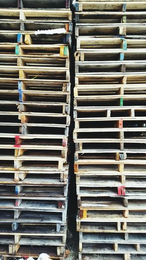 Wood Warehouse Wooden Pallet Pallet Wood Pallets Stacked Everything In Its Place Colors Rainbow Urban In Order Organized Chaos Organized Organization Strategic Column EyeEm Best Shots Out Back Indiana Splinter Splinters Transportation Industrial Eye4photography