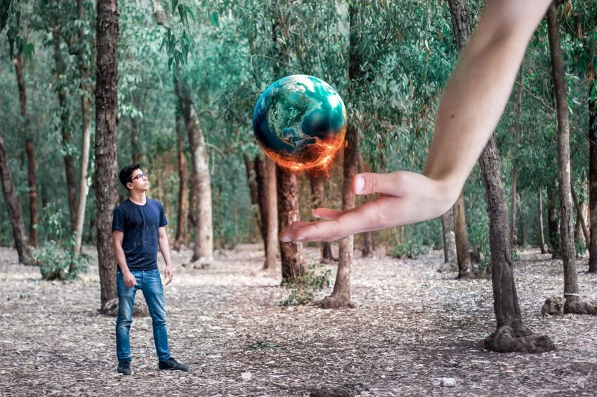 Fire and Ice. Fire Ice Hand Earth Conceptual Concept 365 Idea Forest Man Boy Blue Tshirt EyeEm Best Shots - Nature Nature Green Cold Warm Hello World Grass Decision Surreal