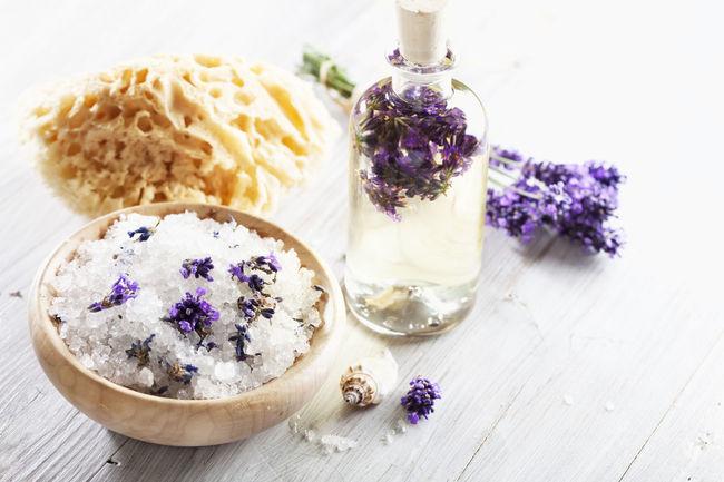 Aromatherapy: lavender bath salt and massage oil Aromatherapy Aromatherapy Oil Bath Salts Beauty Product Bottle Bowl Lavender Massage Oil Scented Still Life