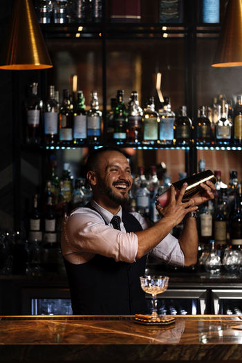 Portrait of man with drink in bar