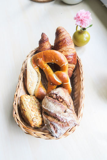 Breadbasket on a table with fresh brezel, croissant and buns Food And Drink Pastries Ready-to-eat Breakfast Breadbasket High Angle View Indoors  Still Life Basket Freshness Bread No People Food Baked Variety Brezel Brötchen Bun Wholemeal Croissant