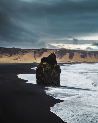 Black sand beach, Iceland Iceland MyStopover Beach Beauty In Nature Blacksandbeach Cloud - Sky Icelandic Land Motion Nature No People Non-urban Scene Outdoors Power In Nature Rock Rock - Object Rock Formation Scenics - Nature Sea Sky Solid Stack Rock Tranquil Scene Tranquility Vik Water Wave My Best Photo