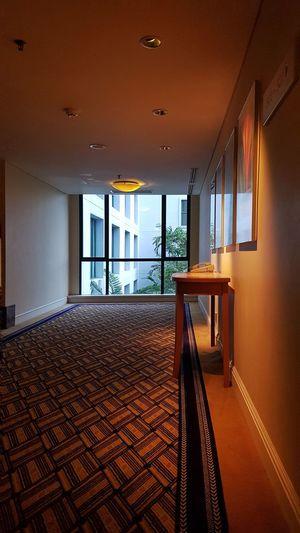 Hallway Walkway Pathway Interior Design Yellow Telephone Booth vanishing point Window Indoors  No People Day