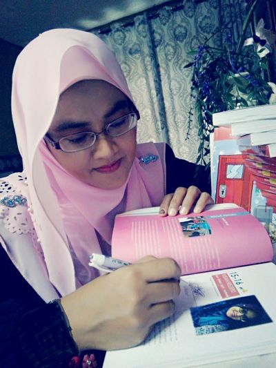 Signing for my beloved readers Publisher Media Indoor Indoors  Hijab Hijabstyle  First Eyeem Photo Book Ideas Gift Bookstairs Bookcase Author Eyeglasses  Men Headshot Archival Close-up Typewriter Author Reading Glasses Literature Bookstore Knowledge