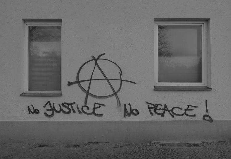 Anarchy Anarchyalliance Architecture Background Black And White Built Structure Bw Cover Creativity Details Freedom Justice Letters In The City No People Old Building  Peace Politics Text Typography Wall Wall - Building Feature Window