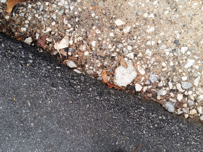 pave and unpaved Pebble Rock Stone Road Paved Unpaved Road Street Transportation Different Difference  Opposite Finished Unfinished Work Facility Infrastructure Shoulder Apshalt Day Side Stone View From Above Perspective Build Structure Urban View Technology Sand