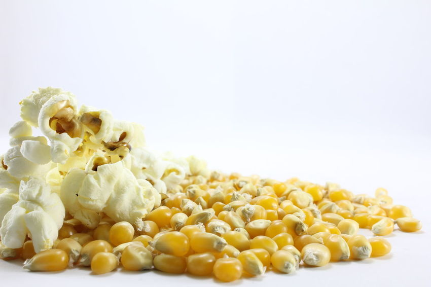Corn kernels for making popcorn on a white background. Corn Kernels For Making Popcorn On A White Background. Close-up Corn Day Food Food And Drink Freshness Healthy Eating Indoors  No People Ready-to-eat Studio Shot White Background Yellow