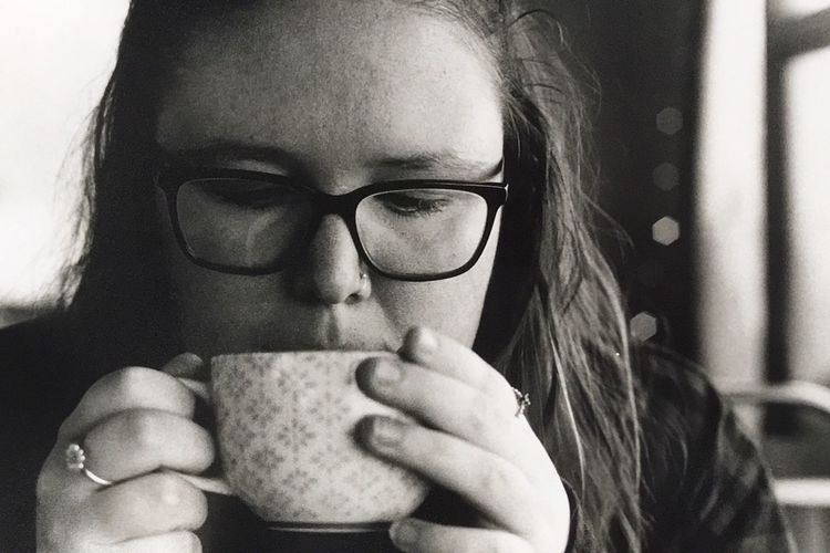 Portraits & Coffee Real People Pentax Shootfilm Coffee Blackandwhite Rainy Days EyeEm Selects Eyeglasses  One Person Drinking Indoors  Drink Headshot Portrait Close-up Lifestyles Women Real People People Adult Food And Drink