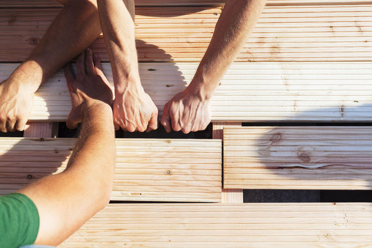 Construction Construction Site DIY Do It Yourself Helping Home Improvement SUPPORT Teamwork Working Building Building Site Close-up Construction Work Garden Handmade Help Helping Hand Men Outdoors Project Real People Team Together Togetherness Wood - Material