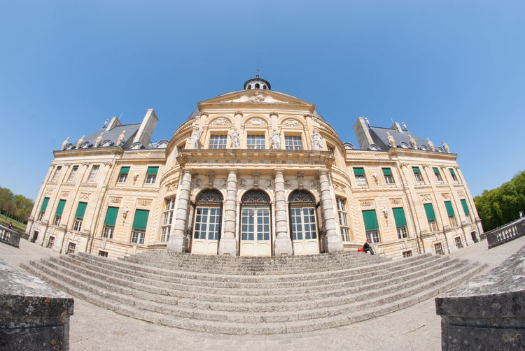 The Chateau De Vaux Le Vicomte Which Is A Baroque French Chateau Located In Maincy, Near Melun, 55 Kilometres Southeast Of Paris Taken With Fisheye Lens. Architecture Beautiful Building Exterior Built Structure Château Clear Sky Day Dome Europe France History History Architecture Holiday Maincy Melun No People Outdoors Paris Sky Structure Tourism Travel Destinations Vicomte
