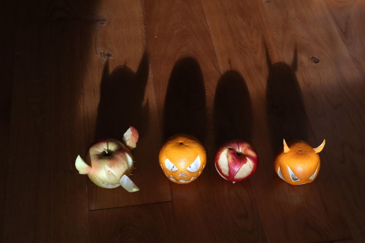 Food Food And Drink Healthy Eating Fruit Indoors  Vegetable Wood - Material Wellbeing Freshness No People Group Of Objects Pumpkin Table Still Life Apple - Fruit Directly Above Celebration Creativity Three Objects Jack O' Lantern Wood