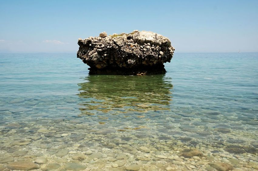 Beach Beauty In Nature Blue Sea And Clear Water Clear Water Cloudless Sky Day Horizon Over Water Nature No People Outdoors Rock - Object Rock Formation Scenics Sea Sky Tranquil Scene Tranquility Water Waterfront Perspectives On Nature