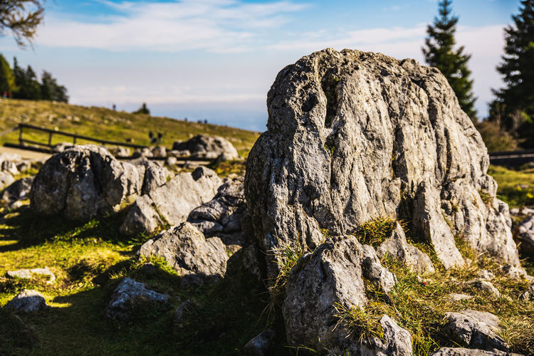 Close-up of rock formation on land against sky