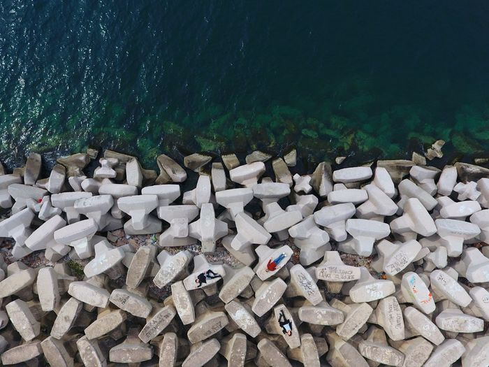 High Angle View Of People On Stones