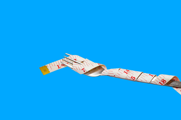 Measure tapes in different positions isolated on blue background
