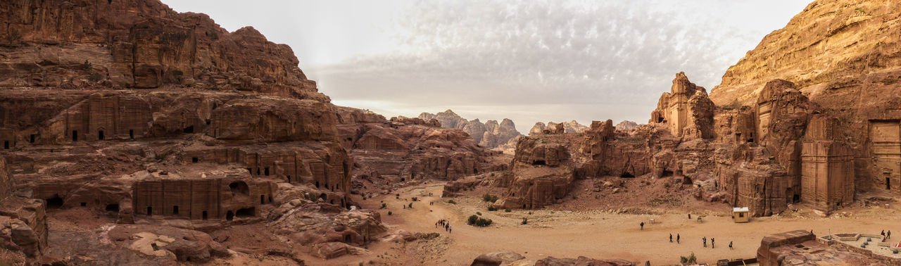Panoramic view of rock formations against sky during sunset
