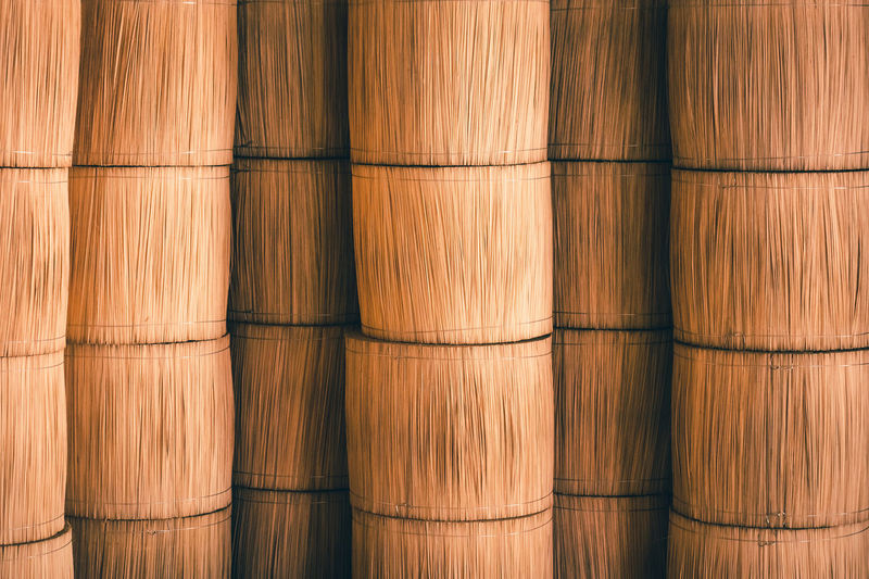 Full frame shot of stacked bamboo containers