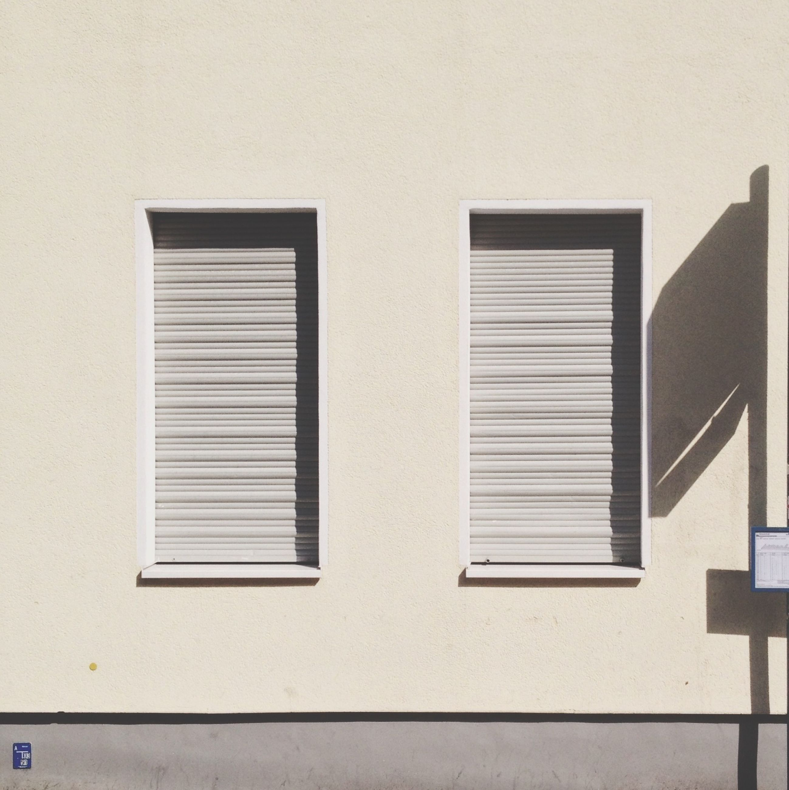 architecture, built structure, building exterior, window, wall - building feature, residential building, building, residential structure, wall, copy space, house, low angle view, day, no people, closed, outdoors, clear sky, pattern, geometric shape, shutter