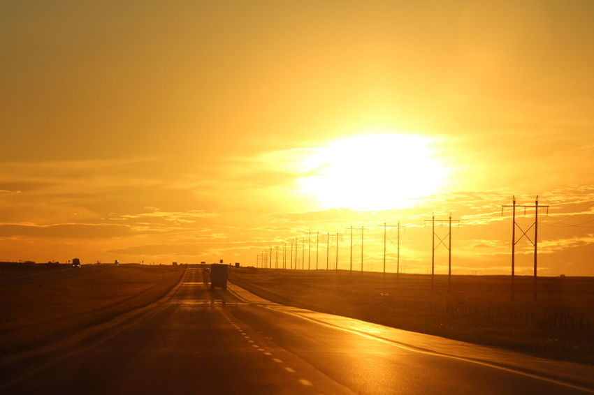 Sunset over the Prairies... City Day Nature No People Outdoors Road Sky Sun Sunlight Sunset The Way Forward Transportation Yellow