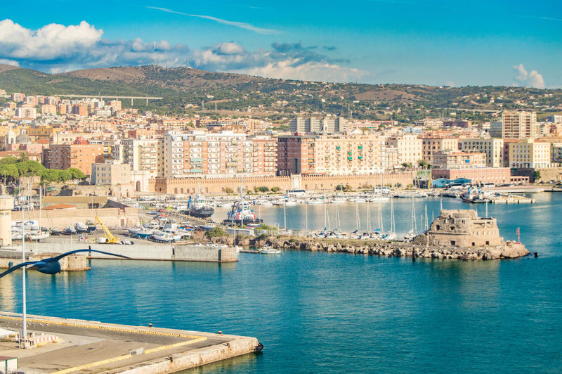 View of civitavecchia, rome's cruise and ferry port. city in the background, sunny day, view from