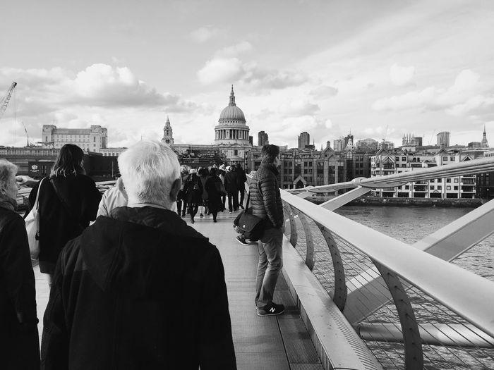 People walking on london millennium footbridge