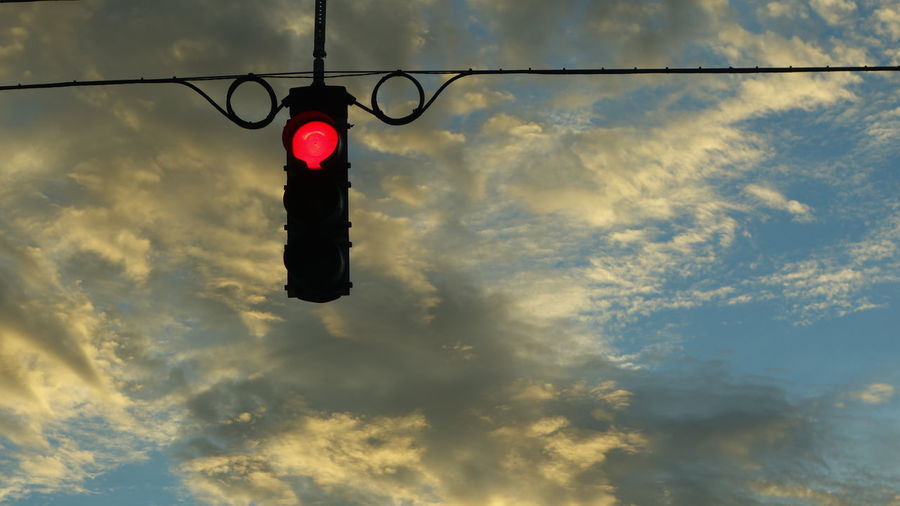 Low angle view of red light against sky