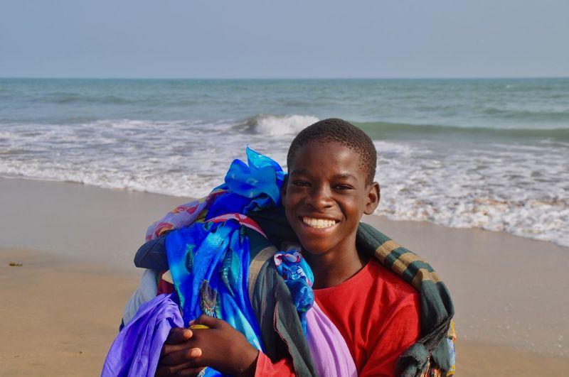 Portrait of smiling boy on beach