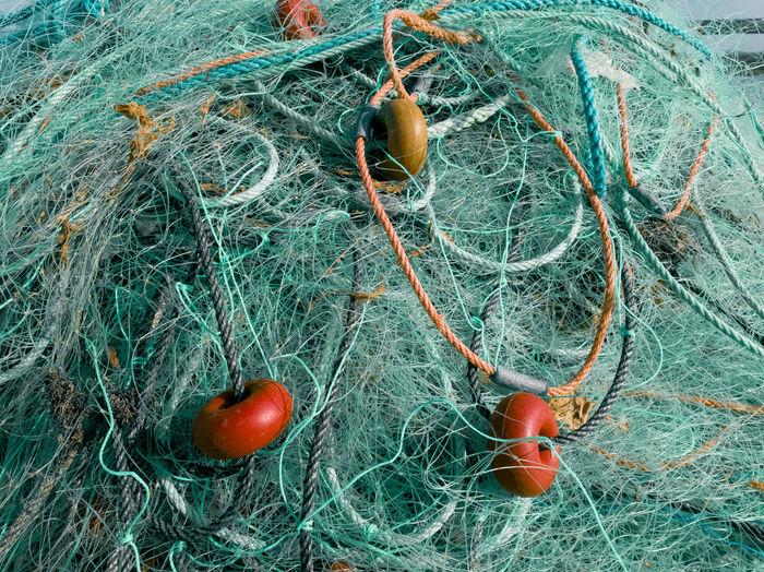 Full frame shot of turquoise fishing net