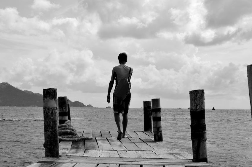 Adult Backpacking Beach Cloud - Sky Day Full Length Men Monochrome Photography Nature Nautical Vessel One Man Only One Person Only Men Outdoors People Real People Rear View Sea Sky Standing Water Finding New Frontiers Live For The Story