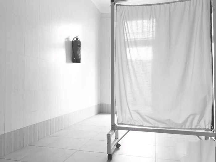 Hospital emergency entrance Black And White Clean Hygiene Emergency Entrance Entrance Fire Extinguisher White Hospital Curtain EyeEm Selects Curtain Indoors  Hanging Window No People Drapes  Illuminated Coathanger Day Home Interior AI Now EyeEm Ready