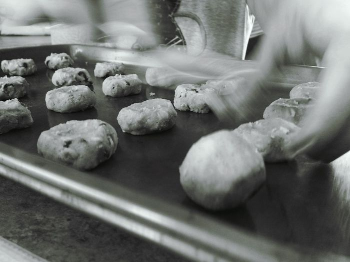 Blurred Motion Of Cropped Hand Making Cookies