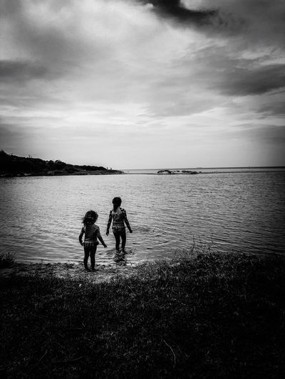 Innocence EyeEm River Blackandwhite Photography Blackandwhite Picoftheday EyeEm Photography EyeEm Gallery Water Sea Sky Real People Cloud - Sky Horizon Horizon Over Water Beach Togetherness Nature Men Silhouette Beauty In Nature People Land Outdoors Lifestyles Scenics - Nature