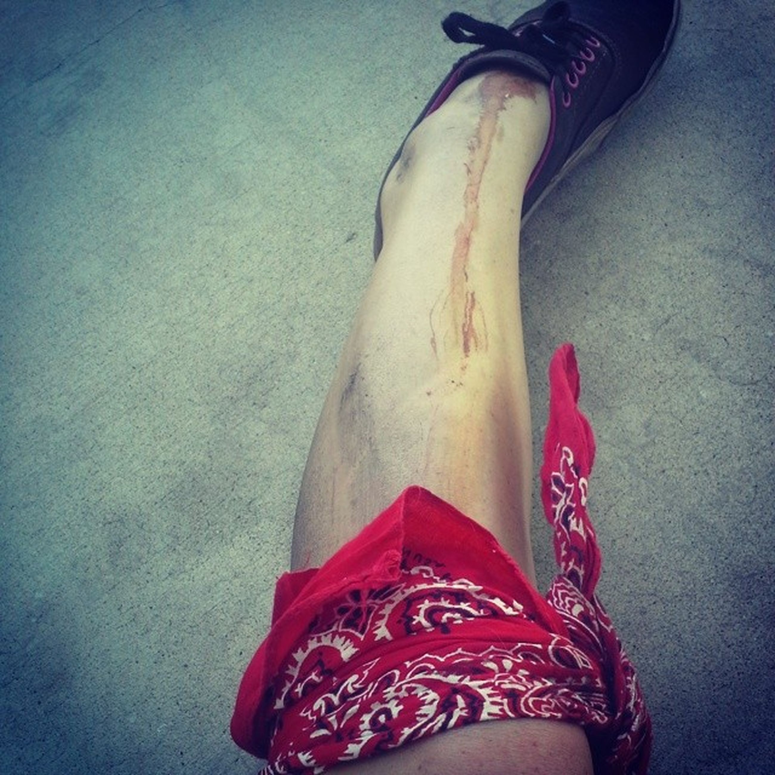 low section, person, shoe, indoors, personal perspective, high angle view, footwear, red, human foot, part of, fashion, close-up, pair, standing, lifestyles, unrecognizable person