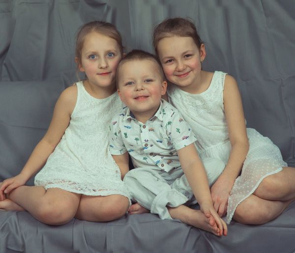 Family Portrait Child Togetherness Men Males  Females Childhood Sitting Bonding Looking At Camera Family Bonds Organized Group Photo Sibling Couple Sister Brother Hugging