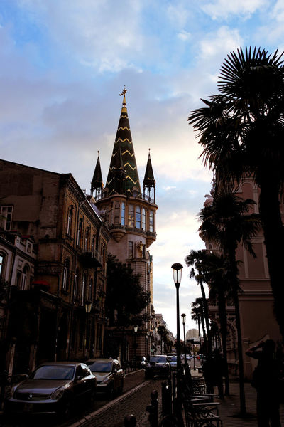 #Georgia #batumi Architecture Building Building Exterior Built Structure Car City Cloud - Sky Land Vehicle Mode Of Transportation Motor Vehicle Nature No People Outdoors Palm Tree Place Of Worship Plant Religion Sky Spire  Street Transportation Tree Tropical Climate
