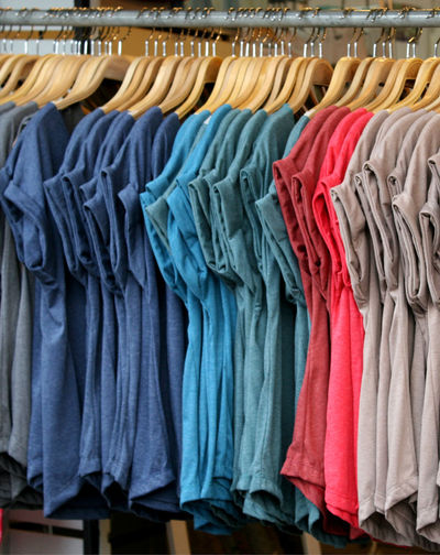 T-shirts with different colors Background Blue Casual Closet Cloth Collection Colorful Cotton Dress Empty Fabric Fashion Garment Green Group Hanging Market Pattern Row Sale Shirt Shop Shot Sleeves Store Striped Textile T-shirts Wardrobe Wear Clothing Retail  Coathanger Choice In A Row Rack Order Shopping Boutique Retail Display Clothing Store Multi Colored Variation
