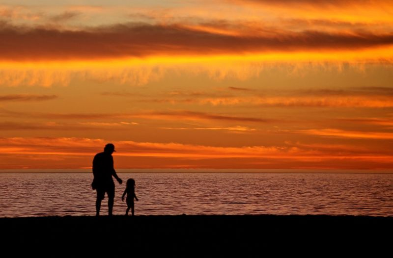 Beauty In Nature Childhood Horizon Over Water Idyllic Light Nature Orange Color Outdoors Poetic Sea Silhouette Sunset Vacations Water