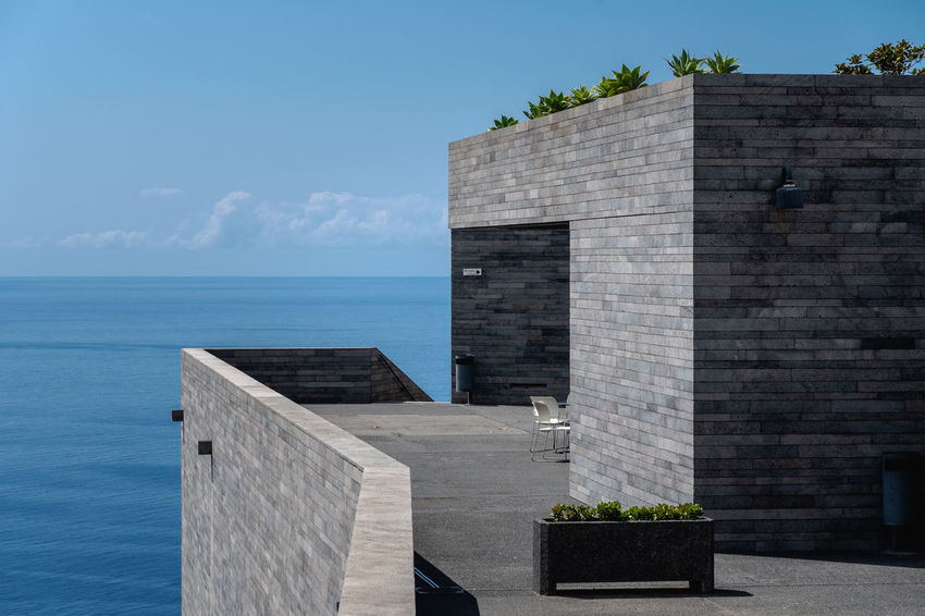 Architecture Built Structure Sky Water Sea Nature Building Exterior Horizon Over Water Horizon Day No People Wall Beauty In Nature Sunlight Building Outdoors Plant Cloud - Sky Wall - Building Feature