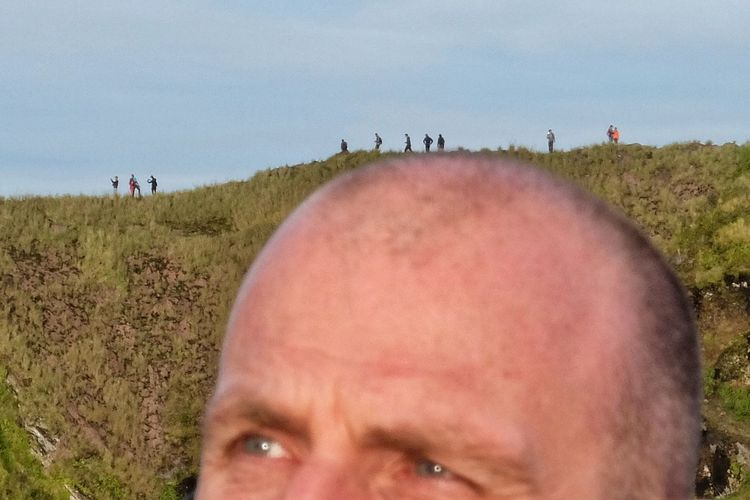 Portrait of man on field against sky