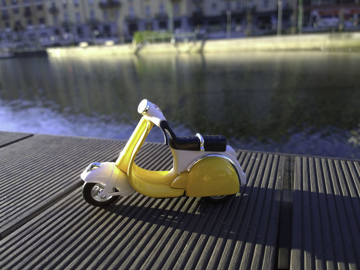 yellow vespa parcked by navigli in Italy Close-up Day Focus On Foreground Nature No People Outdoors Rippled Scooter Selective Focus Vespa Vespa Yellor Water Yellow Yellow Vespa