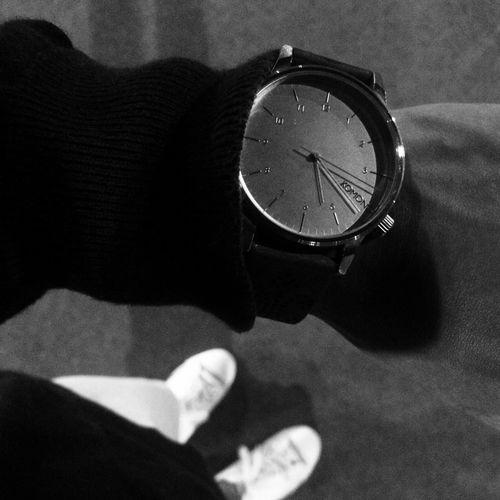 High angle view of human hand on clock