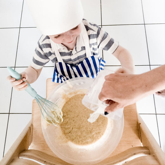 Human Body Part People Activity Cooking Baking Mixing Child Boy Kitchen Life Toddler  Baking Time Cooking Time Day Standing High Angle View Toddler  Mom Mom And Son Mon And Child Food Stories