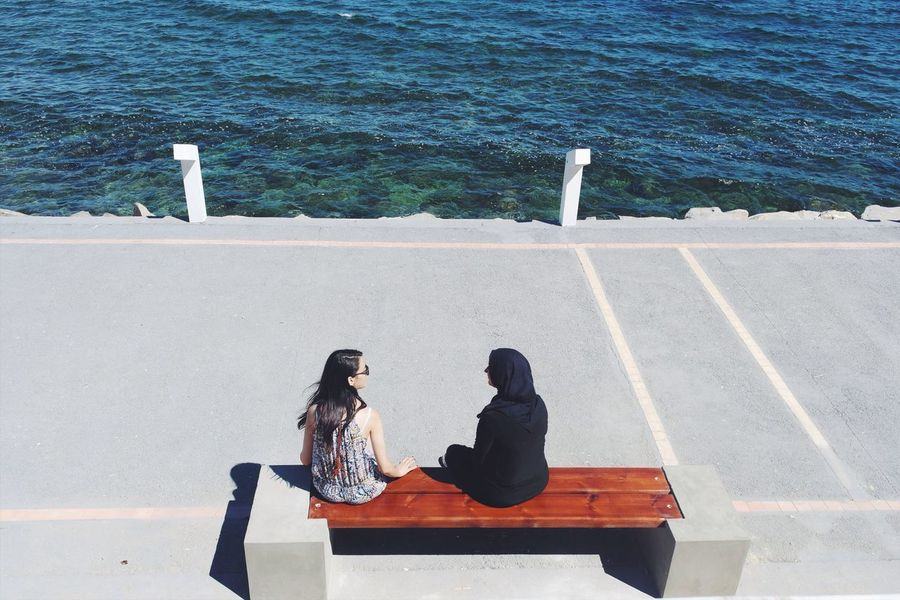 Real People High Angle View Outdoors Day Meeting Friends Port Water Leisure Activity Communication Sea Full Length Sitting Wireless Technology Lifestyles Shadow Women Nature Adult People Marina Women Around The World EyeEm Gallery Lines Summer Show Case July Summer Exploratorium