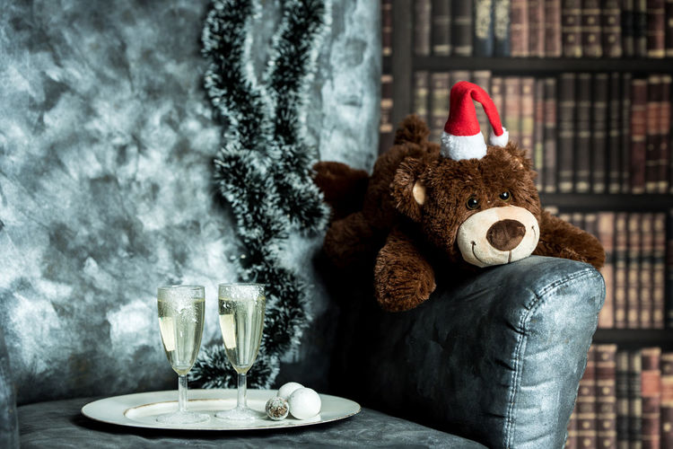 Merry Christmas Books Teddy Bear Toy Atmosphere Evening Christmas Champagne Christmas Decoration Christmas Celebration Christmas Lights Christmas Ornament Celebration Event Tradition Table Santa Claus Santa Hat Christmas Present Gift December Holiday Moments