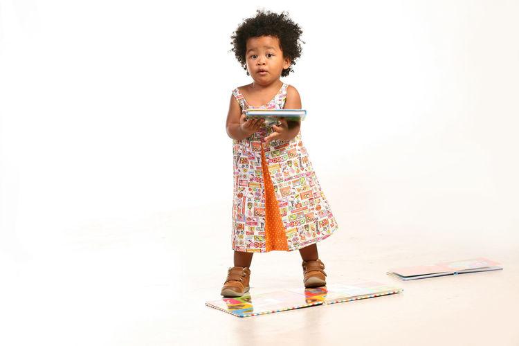 Toddler Girl Holding A Book