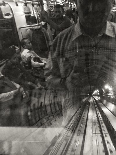 Tunneling our reflection Real People High Angle View Lifestyles One Person Transportation Indoors  Public Transportation Day streetphography