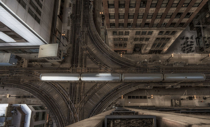 High angle view of elevated tracks along built structures